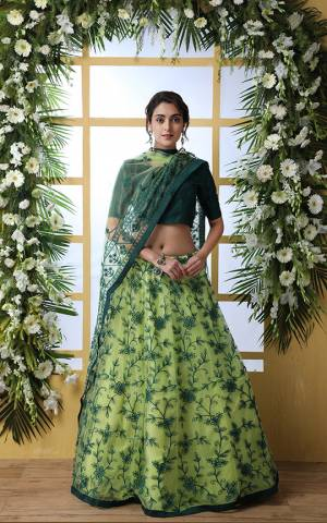Here Is A Very Pretty Designer Lehenga Choli In Pine Green Colored Blouse Paired With Light Green Colored Lehenga And Dupatta. Its Blouse Is Fabricated On Art Silk Paired With Net Fabricated Lehenga And Dupatta. It Is Beautified With Pretty Thread Embroidery and Stone work