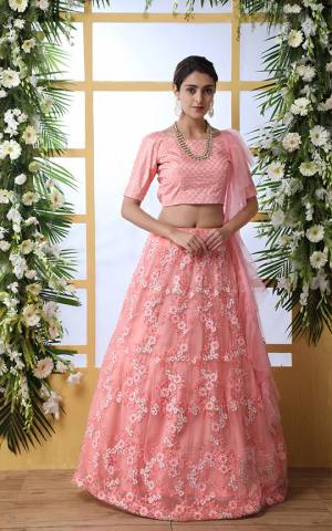 Look Pretty In This Very Beautiful , Elegant Designer Lehenga Choli In All Over Pink Color. Its Blouse Is Silk Based Paired With Net Fabricated Lehenga And Dupatta. Buy This Pretty Piece Now.