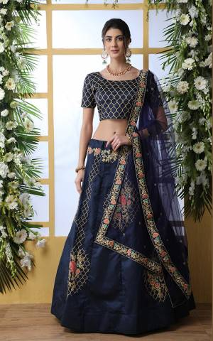 Enhance Your Personality Wearing This Heavy Designer Lehenga Choli In All Over Navy Blue Color. This Lehenga And Choli Are Fabricated On Art Silk Paired With Net Fabricated Dupatta. It Is Beautified With Attractive Jari And Thread Work.