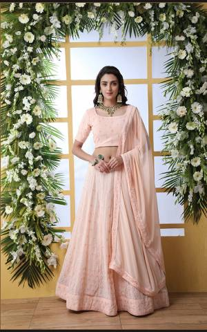 You Will Definitely Earn Lots Of Compliments Wearing This Designer Lehenga Choli In Very Pretty Light Peach Color. This Lovely Tone To Tone Embroidered Lehenga Choli And Dupatta Are Fabricated Georgette Which Is Light Weight And Easy To Carry All Day Long.
