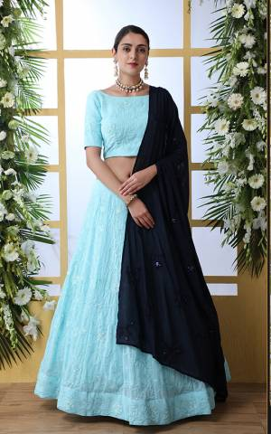 Grab This Bold And Beautiful Look Designer Lehenga Choli In Sky Blue Color Paired With Navy Blue Colored Dupatta. This Elegant Lehenga Choli And Dupatta Are Fabricated Georgette Beautified With Tone To Tone Embroidery.