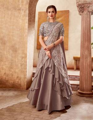 A  fashionable plunge towards a more stylish festive look , this lehenga-saree is a perfect pick to up the tempo of your fashion sense . Pair with a single-piece of jewelry to look mesmerizing.