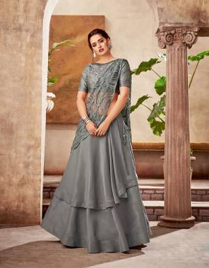 Break the monotony of routine ethnic wear and embrace this monotone grey lehenga saree instead to give that much needed spark to your look and make you appear ahead of time.