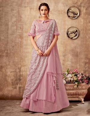 Enriched with interesting cuts, patterns , layers and embroidery, this subtly stylish lehenga saree will take you to the centre of the spotlight . Pair with a statement making earring and multi-ring stack to look stylish.