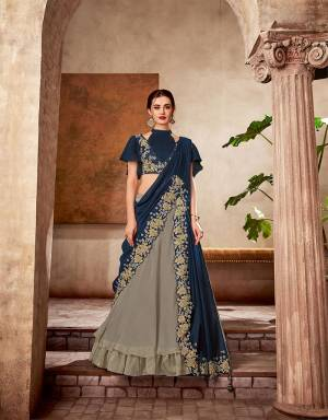 Induce an aura of high-fashion glamour while keeping the traditions at bay in this one-of-a-kind double pallu style lehenga saree embellished with ribbon embroidery details.