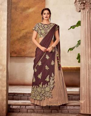 Welcome the new-norm when it comes to festive dressing in this exclusive two-layered lehenga - a crush-fabric skirt and an elaborately embroidered layer on it and cast a majestic spell.