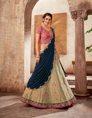 A majestic union of vibrant hues , intricate weaves and classic embroideries, this eternal style lehenga saree will give you a royal glimpse of past while adhering to the modern aspects of fashion.
