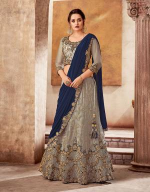 Make the cut in terms of style and panache in this elegantly embroidered lehenga saree fit for all the festivities. Pair with your favourite ethnic jewels and look mesmerizing.
