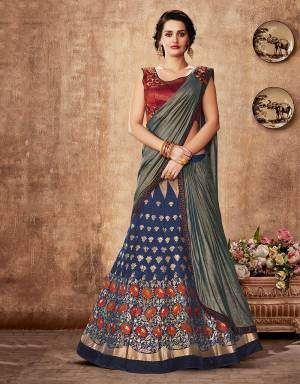 Awaken your love for traditional weaves , aesthetics and colors in this jacquard silk lehenga saree and reignite the sheer elegance of ethnic details.