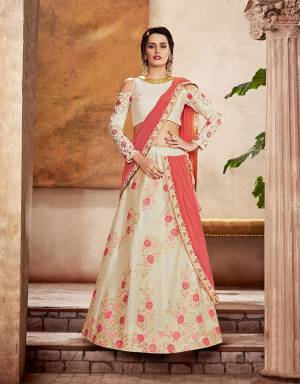 Enter the realm of pristine vibes in this soft white lehenga saree with delicate pink floral weaves and exude a clean, classy and romantic appeal