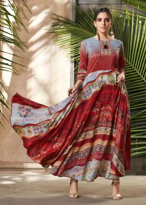 For Your Semi-Casual Wear, Grab This Readymade Gown In Red And Grey Color Beautified With Prints All Over. It Is Fabricated On Soft Silk Which Is Light Weight, Durable And Easy To care For.