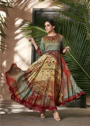 Celebrate This Festive Season With Beauty And Comfort Wearing This Designer Readymade Gown In Multi Color Fabricated On Soft Silk. This Pretty Gown Is Beautified With Digital Prints All Over. Buy Now.