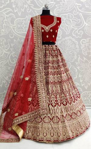 Get Ready For Your D-Day With This Heavy Designer Lehenga Choli In Maroon Color. This Heavy Embroidered Lehenga Choli Is Fabricated On Velvet Paired With Net Fabricated Dupatta. It Is Beautified With Heavy Jari Embroidery And Stone Work. Buy This Bridal Lehenga Now