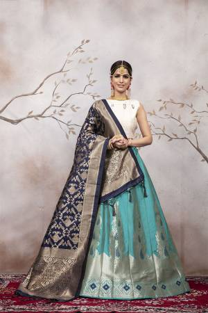 Here Is A Very Beautiful Silk Based Designer Lehenga Choli In White Colored Blouse Paired With Blue Colored Lehenga And Navy Blue Colored Dupatta. This Lehenga Choli Is Silk based Giving A Rich And Elegant Llook To Your Personality.
