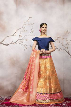 Go Colorful with Thid Very Designer Lehenga Choli In Navy Blue Colored Blouse Paired With Orange Colored Lehenga And Dark Peach Colored Dupatta. This Lehenga Choli And Dupatta Are Silk Based Beautified With Weave. Buy Now.