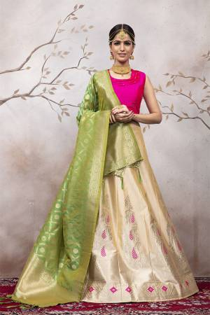 Add This Very Pretty Designer Lehenga Choli To Your Wardrobe In Rani Pink Colored Blouse Paired With Cream Colored Lehenga And Green Colored Dupatta. This Lehenga Choli Is Silk Based Beautified With Attractive Weave. Buy Now.