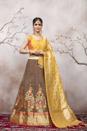 Celebrate This Festive And Wedding Season Wearing This Pretty Designer Lehenga Choli In Musturd Yellow Colored Blouse And Dupatta Paired With Light Brown Colored Lehenga. This Silk Based Lehenga Choli Will Give A Rich Look To Your Personality.