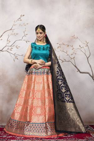Here Is A Very Beautiful Silk Based Designer Lehenga Choli In Blue Colored Blouse Paired With Peach Colored Lehenga And Navy Blue Colored Dupatta. This Lehenga Choli Is Silk based Giving A Rich And Elegant Llook To Your Personality.