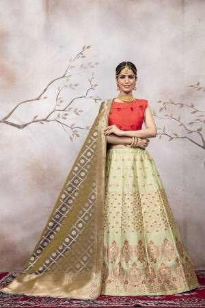 Go Colorful with Thid Very Designer Lehenga Choli In Orange Colored Blouse Paired With Pastel Green Colored Lehenga And Grey Colored Dupatta. This Lehenga Choli And Dupatta Are Silk Based Beautified With Weave. Buy Now.