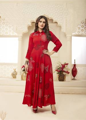 Add This Beautiful Readymade Gown To Your Wardrobe In Red Color. This Pretty Gown Is Fabricated On Rayon Beautified With Prints All Over. This Gown Is Soft Towards Skin Which Is Light Weight And Easy To Carry All Day Long.