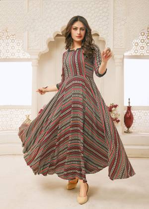 You Will Definitely Earn Lots Of Compliments Wearing This Readymade Gown In Multi Color. This Pretty Gown With Rich And Elegant Prints Is Fabricated on Rayon Which Is Soft Towards Skin and Easy To Carry All Day Long.