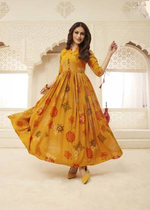 Here Is A Very Pretty Designer Readymade Gown In Musturd Yellow Color Fabricated on Rayon. This Gown Is Beautified With Prints And It Is Soft Towards Skin Which Is Easy To Carry All Day Long.