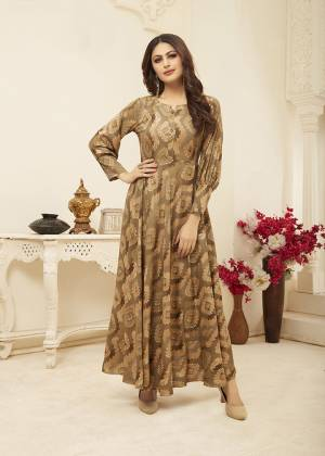 Flaunt Your Rich And Elegant Taste Wearing This Designer Readymade Elegant Looking Gown In Rich Beige Color. This Gown Is Rayon Based Beautified With Prints All Over. Its Fabric Ensures Superb Comfort all Day Long, Buy Now.