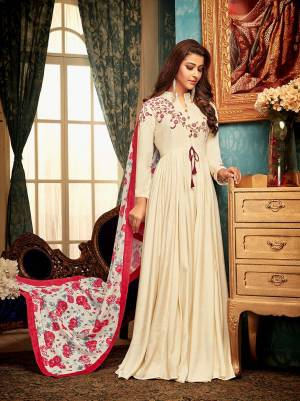 Flaunt Your Rich and Elegant Taste Wearing This Designer Readymade Gown In Cream Color Paired With White And Pink Colored Dupatta. This Pretty Set Of Gown And Dupatta Are Fabricated On Muslin Beautified With Prints And Embroidery.