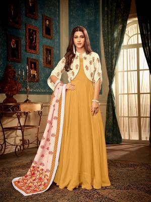 Celebrate This Festive Season With Beauty And Comfort Wearing This Readymade Deisgner Gown In Musturd Yellow Color Paired With Lovely Cream Colored Jacket And Multi Colored Dupatta. This Set Is Fabricated Muslin Which Ensures Superb Comfort All Day Long.