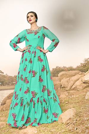 Celebrate This Festive Season With And Comfort Wearing This Designer Readymade Gown In Sea Green Color, This Gown Is Georgette Based Beautified With Floral Prints All Over.