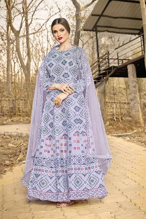 Celebrate This Festive Season With And Comfort Wearing This Designer Readymade Gown In Grey Color, This Gown Is Art Silk Based Paired With Net Fabricated Dupatta.