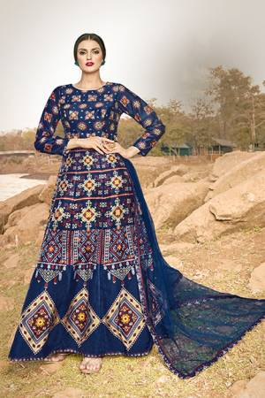 Celebrate This Festive Season With And Comfort Wearing This Designer Readymade Gown In Navy Blue Color, This Gown Is Art Silk Based Paired With Net Fabricated Dupatta.