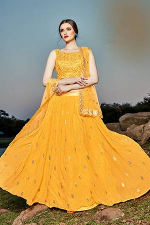 Grab This Pretty Designer Lehenga Choli In Yellow Color. Its Blouse And Lehenga Are Fabricated on Georgette Paired With Net Fabricated Dupatta.