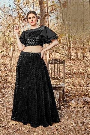 For A Bold And Beautiful Look Grab This Designer Readymade Pair Of Crop Top And Skirt In Black Color. This Pretty Pair Is Velvet Based Beautified With Sequence Work.