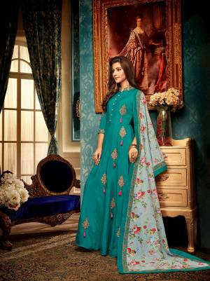 You Will Definitely Earn Lots Of Compliments Wearing This Designer Readymade Gown In Teal Blue Color Paired With A Very Pretty Digital Printed Dupatta In Pastel Blue Color. This Lovely Pair Is Fabricated On Muslin Beautified With Detailed Embroidery. Buy Now.