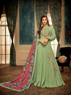 Celebrate This Festive Season Wearing This Readymade Gown In Light Green Color Paired With Contrasting Pink And Multi Color Dupatta. This Pretty Embroidered Gown And Digital Printed Dupatta Are Muslin Based Which IS Soft Towards Skin And Easy To Carry All Day Long.