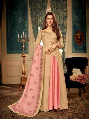 You Will Definitely Earn Lots Of Compliments Wearing This Designer Readymade Gown In Beige Color Paired With A Very Pretty Digital Printed Dupatta In Pink Color. This Lovely Pair Is Fabricated On Muslin Beautified With Detailed Embroidery. Buy Now.