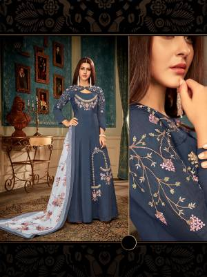 Celebrate This Festive Season Wearing This Readymade Gown In Navy Blue Color Paired With Contrasting Grey Color Dupatta. This Pretty Embroidered Gown And Digital Printed Dupatta Are Muslin Based Which IS Soft Towards Skin And Easy To Carry All Day Long.
