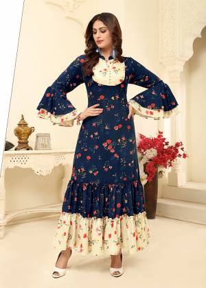 You Will Definitely Earn Lots Of Compliments Wearing This Readymade?Gown In Navy Blue Color. This Pretty Gown With Rich And Elegant Prints Is Fabricated on Rayon Which Is Soft Towards Skin and Easy To Carry All Day Long.?