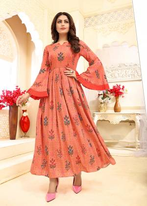 Celebrate This Festive Season With Beauty And Comfort Wearing This?Designer Readymade Gown In Orange Color Fabricated On Rayon. It Is Beautified With Prints. Buy Now