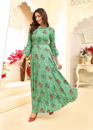 Flaunt Your Rich And Elegant Taste Wearing This Designer Readymade?Elegant Looking Gown In Rich Sea Green Color. This Gown Is Rayon Based Beautified With Prints All Over. Its Fabric Ensures Superb Comfort all Day Long, Buy Now.