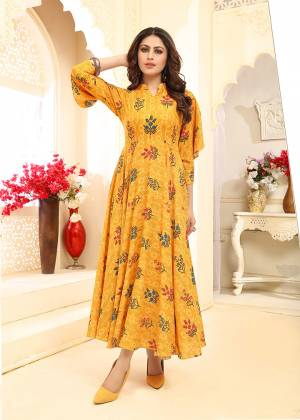 Add This Beautiful Readymade Gown To Your Wardrobe In Yellow Color. This Pretty Gown Is Fabricated On Rayon Beautified With Prints All Over. This Gown Is Soft Towards Skin Which Is Light Weight And Easy To Carry All Day Long.