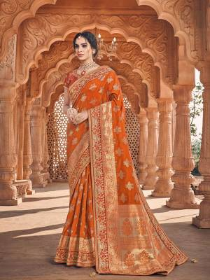 Celebrate This Festive And Wedding Season With This Heavy Designer Saree In Rust Orange Which Comes With Two Designer Blouses, One Simple Plain Blouse And Another Designer Embroidered Blouse. This Pretty Saree Is Fabricated On Jacquard Silk Paired With Art Silk Fabricated Blouses.