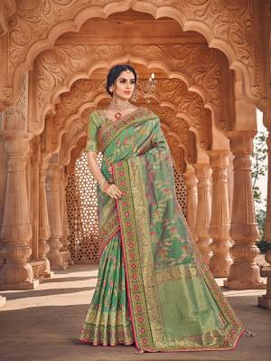 Here Is A Very Pretty Heavy Designer Saree Which Comes With Two Blouses. This Beautiful Light Green Colored Heavy Embroidered Saree Is Fabricated On Jacquard Silk Paired With A Plain Art Silk Blouse And Another Embroidered Art Silk Fabricated Blouse. Buy This Pretty Saree Now.
