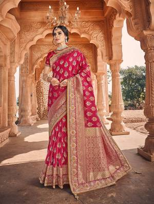 Celebrate This Festive And Wedding Season With This Heavy Designer Saree In Dark Pink Which Comes With Two Designer Blouses, One Simple Plain Blouse And Another Designer Embroidered Blouse. This Pretty Saree Is Fabricated On Jacquard Silk Paired With Art Silk Fabricated Blouses.