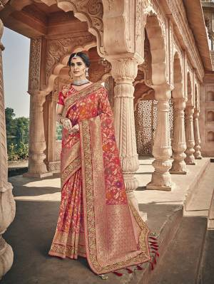 Here Is A Very Pretty Heavy Designer Saree Which Comes With Two Blouses. This Beautiful Dark Orange Colored Heavy Embroidered Saree Is Fabricated On Jacquard Silk Paired With A Plain Art Silk Blouse And Another Embroidered Art Silk Fabricated Blouse. Buy This Pretty Saree Now.
