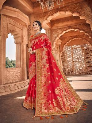Here Is A Very Pretty Heavy Designer Saree Which Comes With Two Blouses. This Beautiful Red Colored Heavy Embroidered Saree Is Fabricated On Jacquard Silk Paired With A Plain Art Silk Blouse And Another Embroidered Art Silk Fabricated Blouse. Buy This Pretty Saree Now.