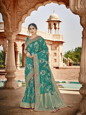 Celebrate This Festive And Wedding Season With This Heavy Designer Saree In Blue Which Comes With Two Designer Blouses, One Simple Plain Blouse And Another Designer Embroidered Blouse. This Pretty Saree Is Fabricated On Jacquard Silk Paired With Art Silk Fabricated Blouses.