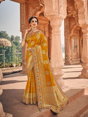 Here Is A Very Pretty Heavy Designer Saree Which Comes With Two Blouses. This Beautiful Musturd Yellow Colored Heavy Embroidered Saree Is Fabricated On Jacquard Silk Paired With A Plain Art Silk Blouse And Another Embroidered Art Silk Fabricated Blouse. Buy This Pretty Saree Now.
