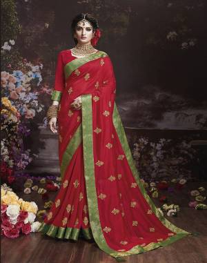 Get Ready For The Upcoming Wedding And Festive Season With This Designer Saree In Red Color. This Attractive Jari Embroidered Saree Is Fabricated On Vichitra Silk Paired With Vichitra Silk Fabricated Blouse. It Is Beautified With Broad Lace Border With Stone Work. Buy Now.
